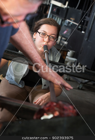 Forming Glass with Blowpipe stock photo, Man helping apprentice with blowing air to form glass by Scott Griessel