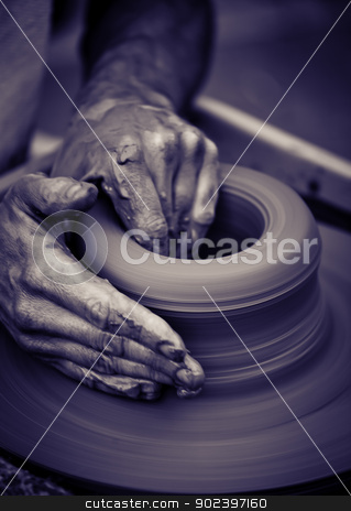 Old man hands working on pottery wheel stock photo, Hands working on pottery wheel , close up retro style toned photo wit shallow DOF by Gordan Poropat