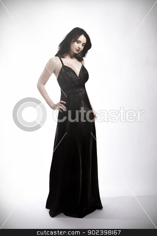 standing young beautiful woman in black dress stock photo, standing young beautiful woman in black dress by Rob Stark