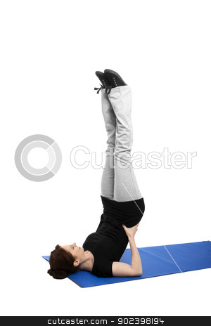 young woman exercising shoulder stand on blue mat