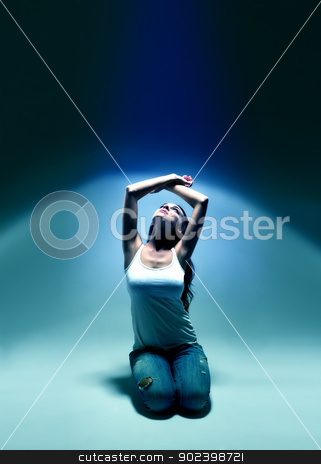 young woman looking upwards into blue spotlight atmosphere stock photo, young woman looking upwards into blue spotlight atmosphere by Rob Stark