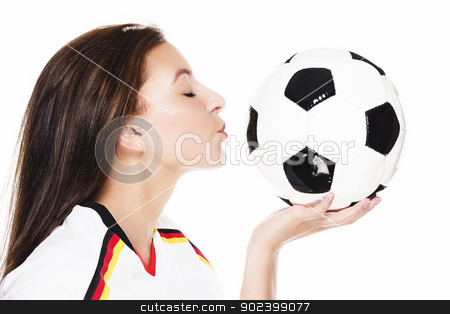 young beautiful woman about to kiss a football on white background stock photo, young beautiful woman about to kiss a football on white background by Rob Stark