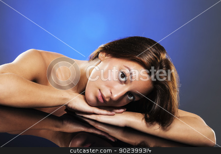 portrait of a young beautiful woman lying on a table with reflection stock photo, portrait of a young beautiful woman lying on a table with reflection by Rob Stark
