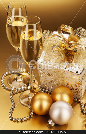 two glasses of champagne with christmas present and christmas balls stock photo, two glasses of champagne with christmas present and christmas balls by Rob Stark