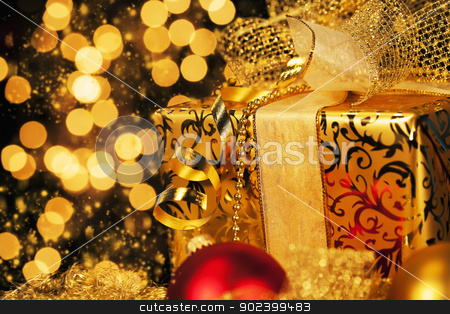 luxury golden christmas gift with sparkling background