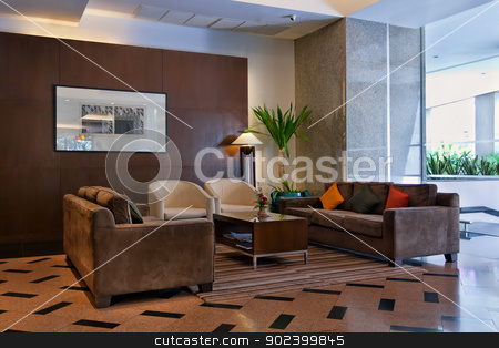 brown sofas the lobby stock photo, brown sofas and coffee table in the lobby by Ruslan Kudrin