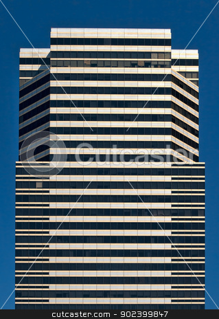 skyscraper stock photo, skyscraper view from below against the blue sky by Ruslan Kudrin