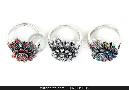 Three silver rings with precious stones stock photo, Three silver rings with precious stones on a white background by Ruslan Kudrin