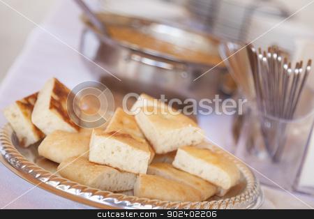 Tray of Fresh Made Italian Bread stock photo, Tray of Fresh Made Italian Bread on Serving Table. by Andy Dean