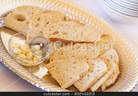 Tray of Fresh Made Sourdough Bread with Garlic Cloves stock photo, Tray of Fresh Made Sourdough Bread with Garlic Cloves on a Serving Table. by Andy Dean