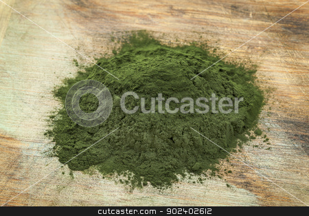 Hawaiian spirulina powder stock photo, a pile of Hawaiian spirulina powder on wooden surface by Marek Uliasz
