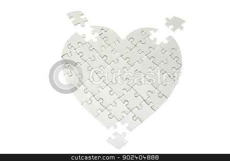 puzzle stock photo, heart made from the puzzle on white by Vitaliy Pakhnyushchyy