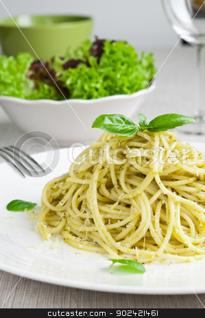 Pasta with Pesto stock photo, Spaghetti pasta with pesto and fresh basil by Tiramisu Studio
