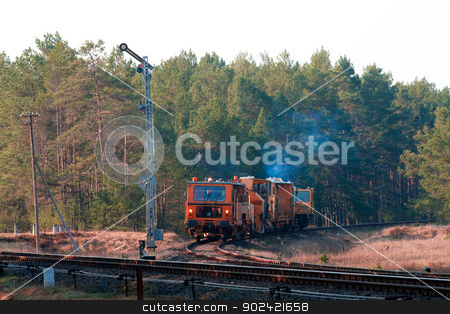 Railway heavy duty machines stock photo, Railway heavy duty machines train entering the station by Jan Remisiewicz