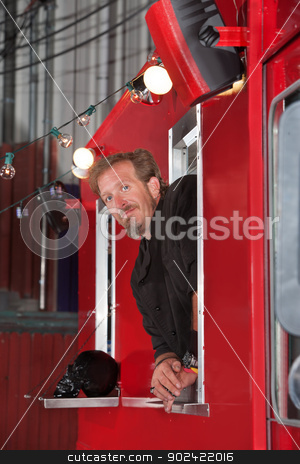 Chef in Food Truck stock photo, Handsome male chef looking outside from mobile restaurant by Scott Griessel