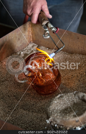 Finishing Glass Art with Blowtorch stock photo, Blowtorch finishing fine art glass object in frit by Scott Griessel