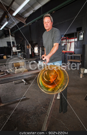 Student Cooling Off Glass Object stock photo, Man cooling off yellow vase he created in school by Scott Griessel