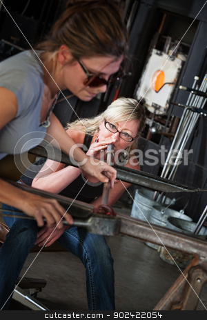 Female Glass Makers stock photo, Female glass art students working together on object by Scott Griessel