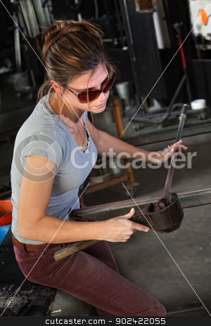 Lady Rolling Glass Art stock photo, Female glass manufacturing business artist working with tools by Scott Griessel