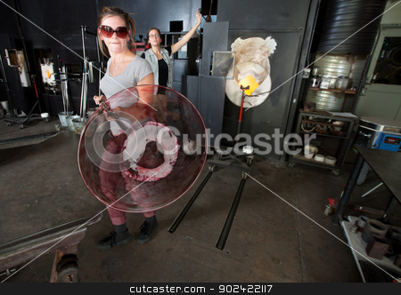 Artist Carrying Plate with Rod stock photo, Serious industrial artist carrying hot plate jar with rod by Scott Griessel
