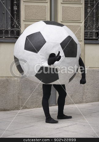 Soccer ball disguise stock photo, Soccer ball disguise on a street with OK sign by ABBPhoto