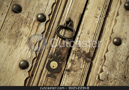 Old lock on a vintage door stock photo, Old lock on a vintage door close up by ABBPhoto
