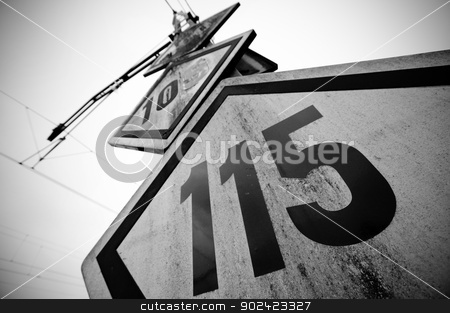 Speed limit railway signpost stock photo, Speed limit railway signpost perspective black and white vignetting by ABBPhoto