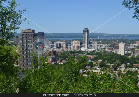 View of Hamilton. stock photo, The view of downtown Hamilton with some high rises and a park in the foreground, and the lake Ontario in the background, from the mountain.  by Horst Petzold