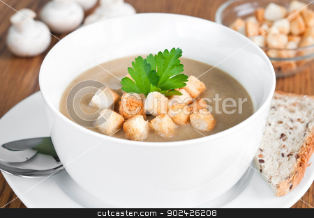 Mushroom Soup stock photo, Mushroom soup with brown bread, croutons and fresh parsley by Tiramisu Studio