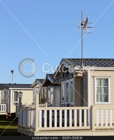 Modern caravans in trailer park stock photo, Side view of modern caravan homes on trailer park, summer scene. by Martin Crowdy