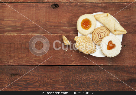 cookies on rustic table stock photo, plate of assorted cookies with crumbs  on a rustic red barn wood table by Marek Uliasz