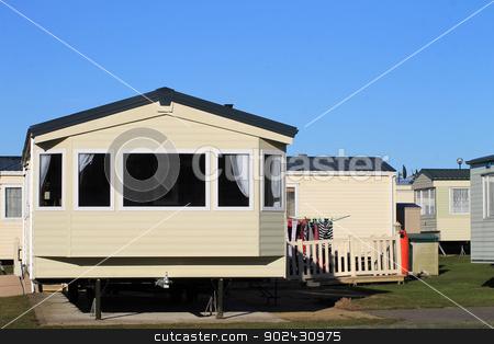 Trailer in caravan park stock photo, Washing outside trailer in caravan park, Scaborough, England. by Martin Crowdy