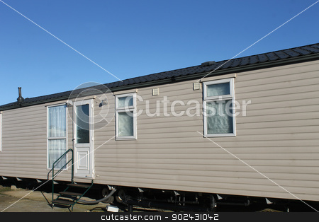 Trailer in caravan park stock photo, Exterior of trailer home in caravan park. by Martin Crowdy