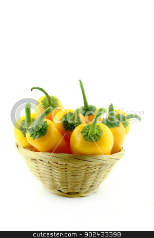 Yellow chili  stock photo, Yellow chili pepper in straw basket on a white background  by Designsstock