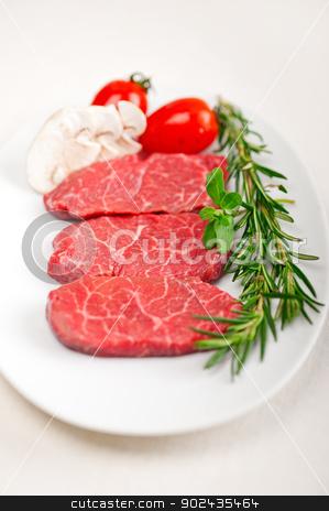 Kobe Miyazaky beef stock photo, raw fresh Kobe Miyazaky beef with rosmary and marjoram by Francesco Perre