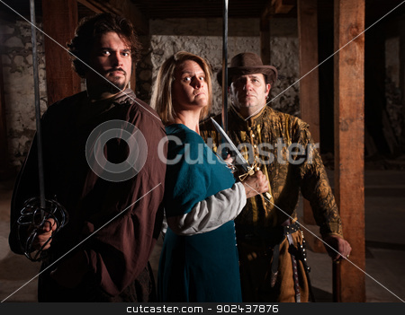 Trio of Medieval Gamers stock photo, Serious group of live action role playing gamers by Scott Griessel