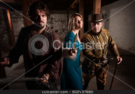 Aggressive Medieval Group stock photo, Aggressive group of people in medieval clothing with weapons by Scott Griessel