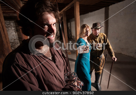 Intimidating Middle Ages Group stock photo, Intimidating middle ages group pointing their swords by Scott Griessel