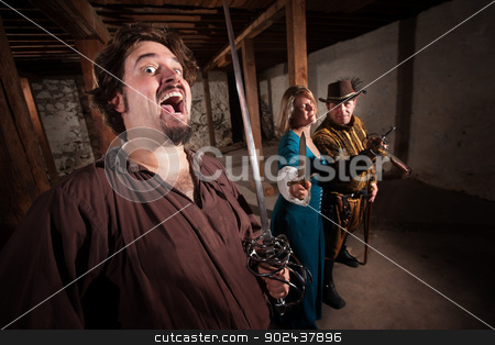 Crazy Swashbucklers with Weapons stock photo, Crazy swashbuckler and group of friends with swords by Scott Griessel