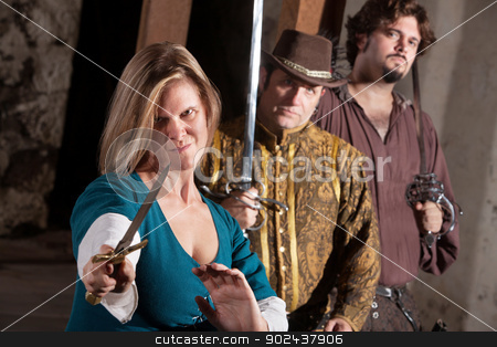 Tough Medieval Lady with Dagger stock photo, Tough smirking medieval woman with dagger and friends by Scott Griessel