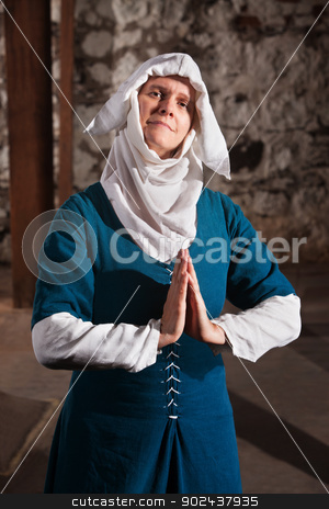 Righteous Medieval Nun stock photo, Righteous medieval nun with palms together in prayer by Scott Griessel