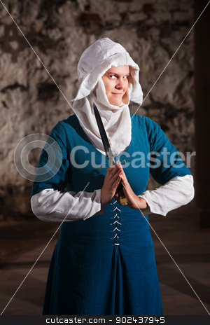 Grinning Nun with Knife stock photo, Grinning nun in middle ages dress holding a dagger by Scott Griessel