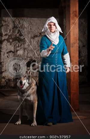 Insulted Nun with Dog stock photo, Insulted medieval nun pointing finger and standing with dog by Scott Griessel