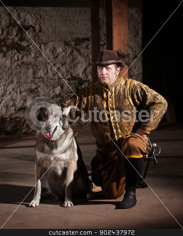 Serious Medieval Man with Dog stock photo, Serious mature medieval mercenary kneeling next to dog by Scott Griessel