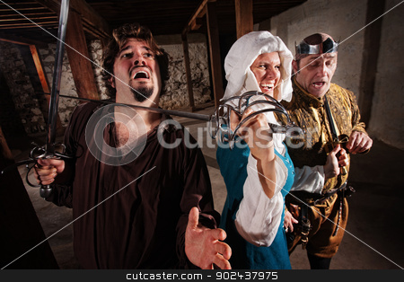 Laughing Lady with Sword on Man stock photo, Tough medieval lady with king and sword on mans neck by Scott Griessel