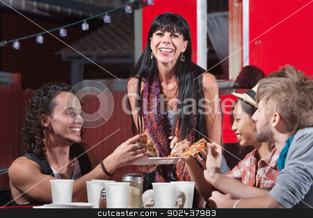 Joyful Group Sharing Pizza stock photo, Joyful group of friends sharing pizza slices outdoors by Scott Griessel