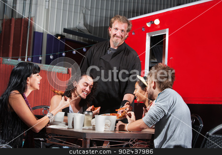 Canteen Owner with Happy Diners stock photo, Smiling pizza canteen owner with happy customers by Scott Griessel