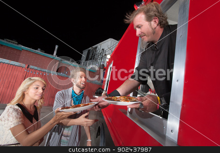 Serving Carryout Pizza from Food Truck stock photo, Chef serving carryout pizza from food truck by Scott Griessel