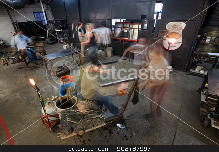 Busy Workers in Glass Workshop stock photo, Busy workers moving in small business glass factory by Scott Griessel