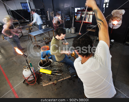 Busy Glass Factory Workers stock photo, Busy group of male and female workers in factory by Scott Griessel